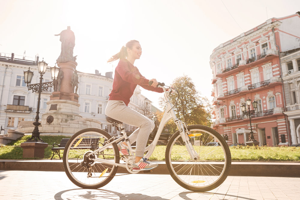 graphicstock-photo-of-young-happy-girl-dressed-in-sweater-walking-with-her-bicycle-in-the-city_BdxqlS1vhl.jpg