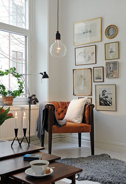 CORNER GALLERY WALL | via  Apartment Therapy