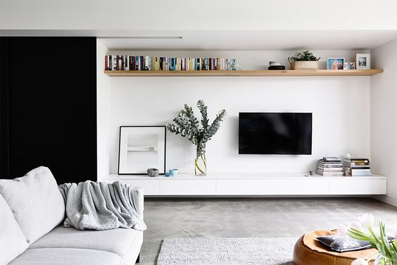 Draw the eye above the TV with an Elevated Floating Shelf |  Heartly