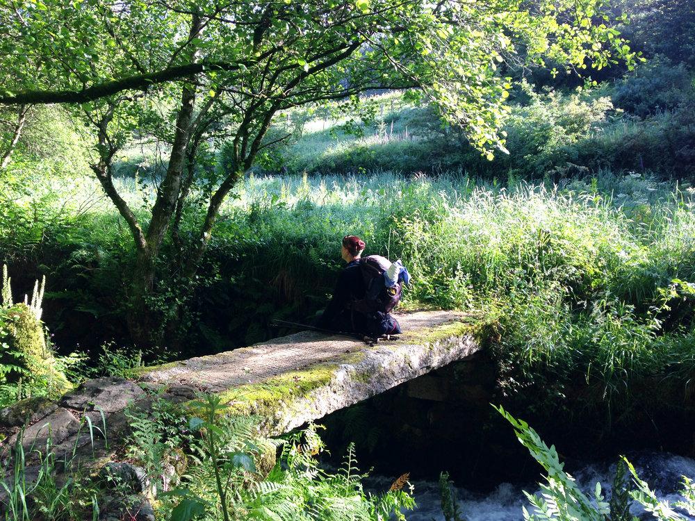 Anne Hughes:  Pilgrim Resting on a Bridge, First Place Life of a Camino Pilgrim
