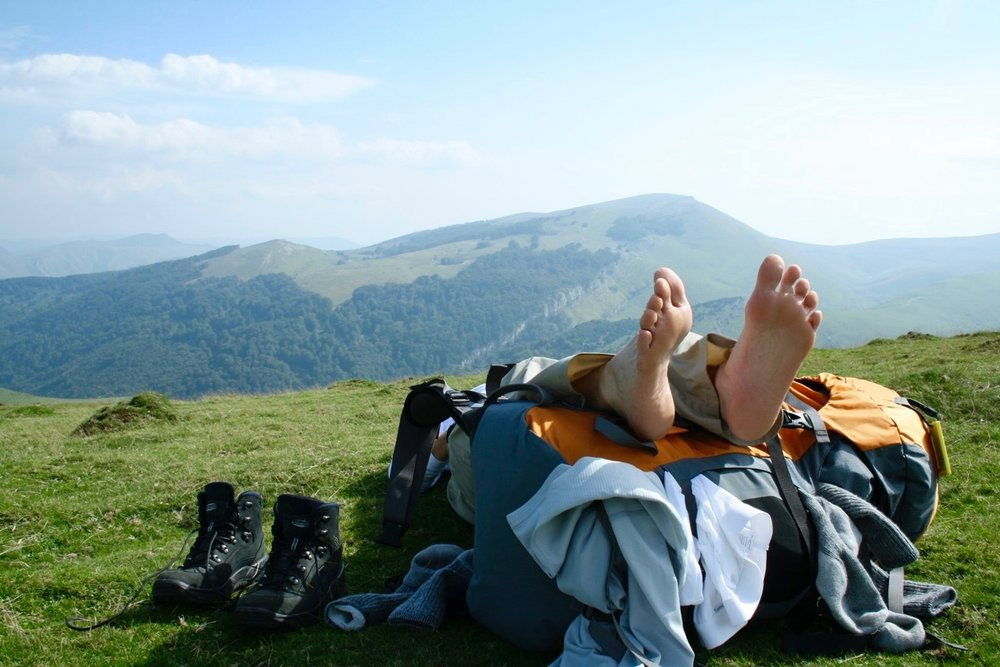 Whichever socks you choose,switching them out during the day can keep your feet dry. This pilgrim is drying some socks and base layer items on his pack as he crosses the Pyrenees.