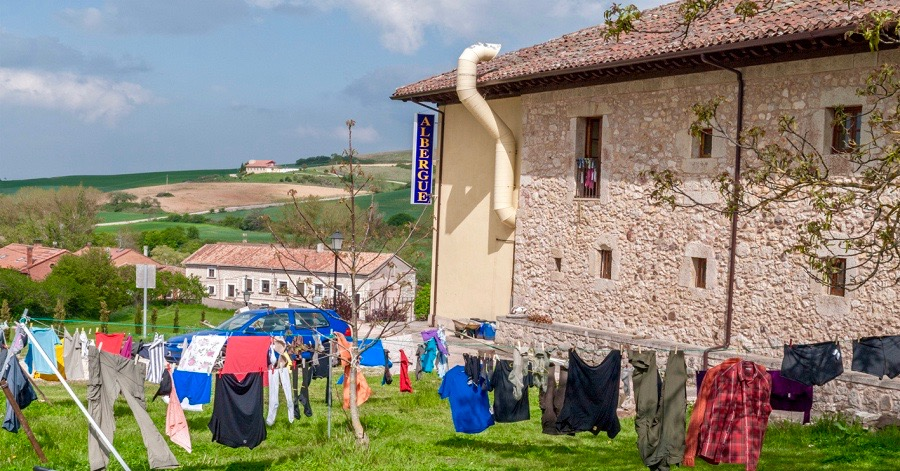 A typical albergue clothesline like this one leads to a funny predicament for Hunter on the way to Santiago.