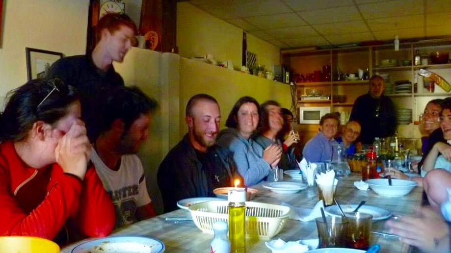 Everyone is eager to celebrate at a simple pilgrim meal.