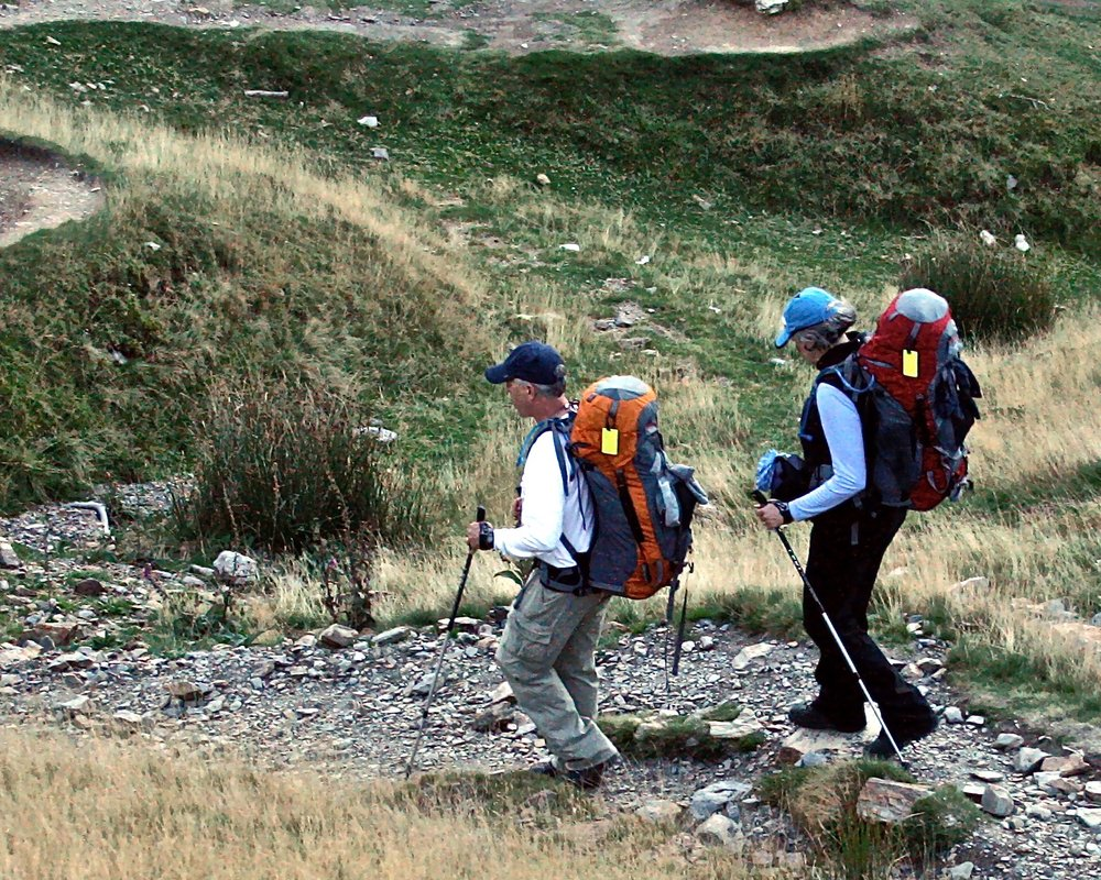 Pilgrims continue the steep descent toward Roncesvalles after scaling the heights of the Pyrenees.
