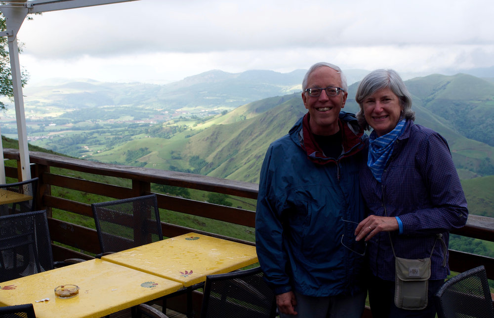 The author and her husband, bedraggled but enjoying the view after a chilly, rainy arrival in Orisson. Grateful for a warm, dry bed, and delicious French family style cooking.