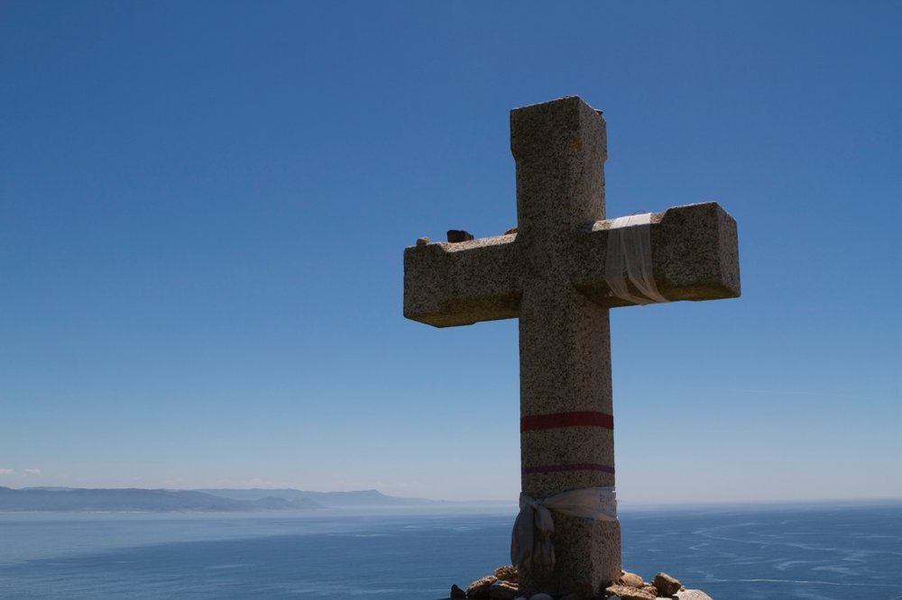 You can't walk farther west. This is the Atlantic Ocean which lies between Spain and the countries of the west. Like the  Cruz de Ferro,  Finisterre offers the pilgrim an opportunity to process the trip, lay down burdens, or post prayers at the foot of the cross.