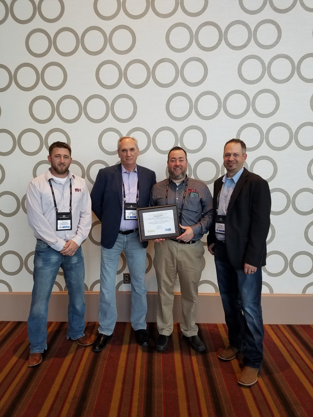 L to R - Butch Schloemann (National Accounts Rep), Michael Morris (President), Jason Fleck (VP - Railroad Division), and Jason Gardner (AVP - Railroad Division) accepting the platinum safety award at the NRC Conference in LA