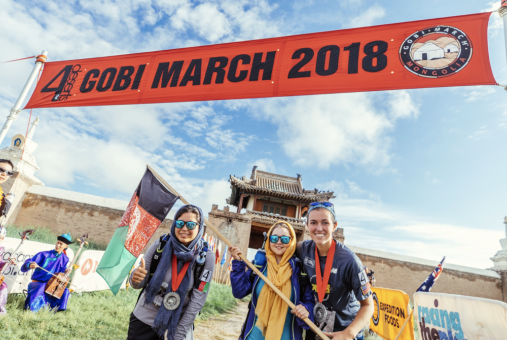 Zeinab, Hasina and Taylor at the finish line of the Gobi March. Photo credit: RacingthePlanet.