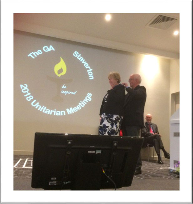 Joan Cook receiving the chain of office from Rev Charles VanDenBroeder, President of the GA from April 2017 to April 2018