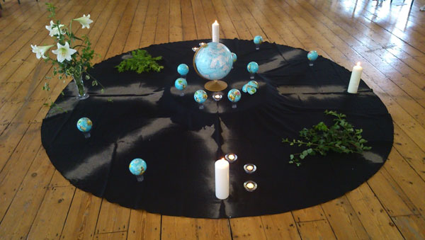 'The worlds within us and the worlds between us', created for OneSpirit interfaith seminary session.. The altar-space: planet earth on many axes, earth in pieces.
