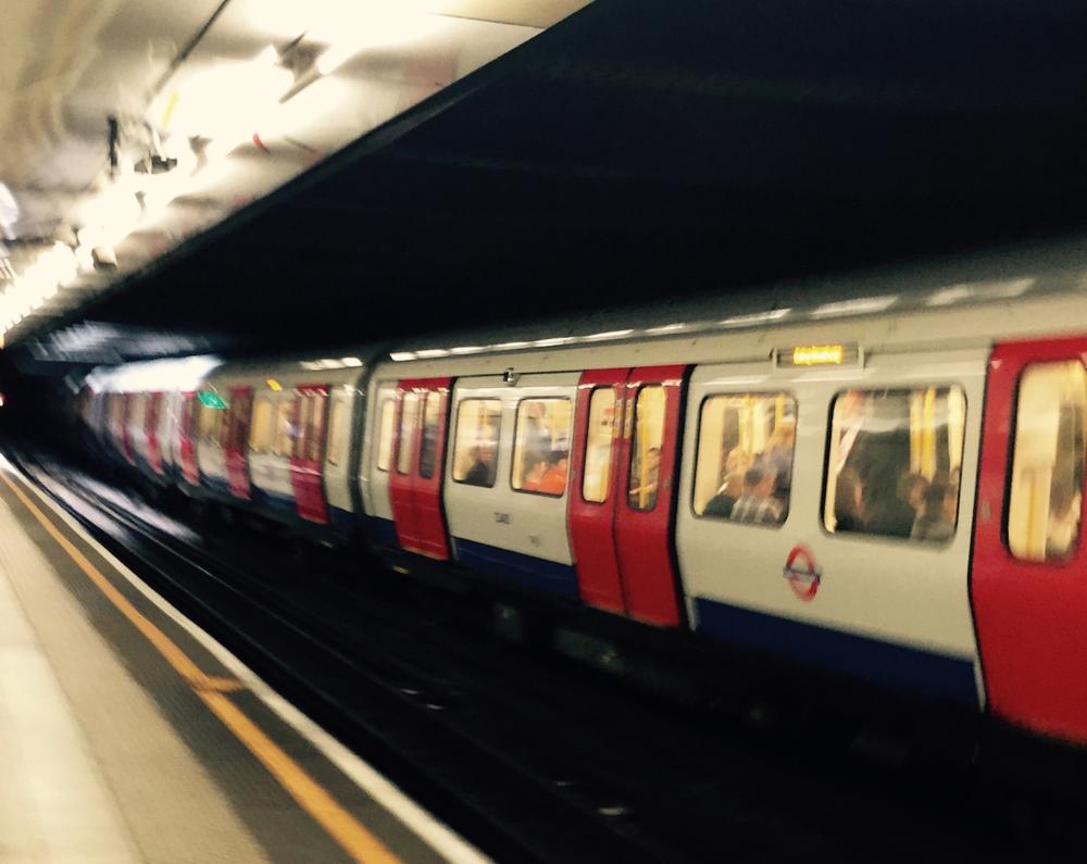 Train at Embankment Tube Stop, London