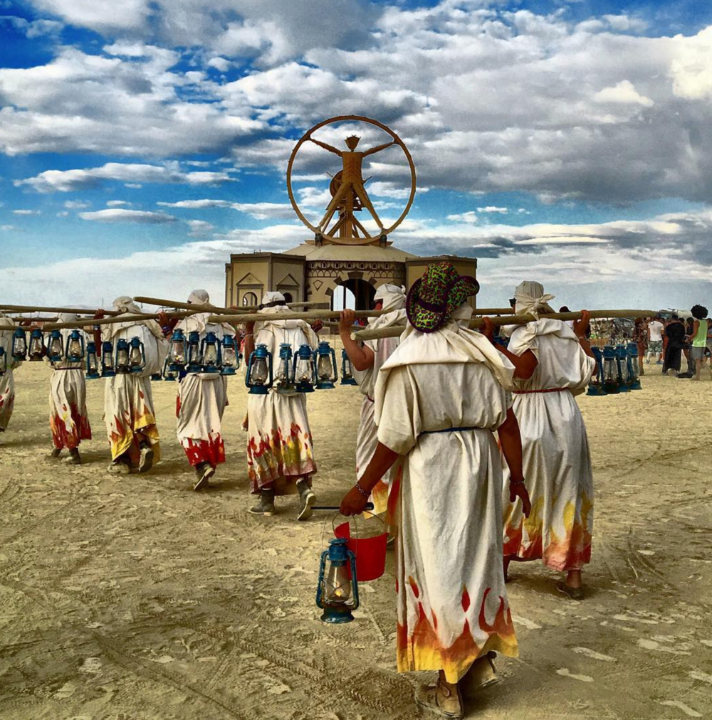 Lamplighters walking the Playa at Burning Man