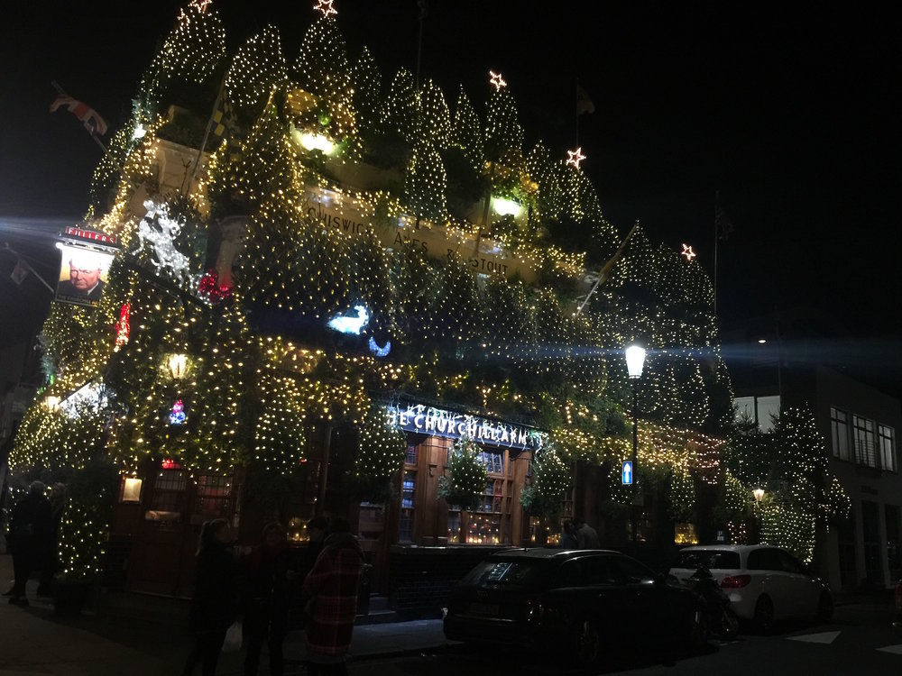 My local pub the Churchill Arms is all decked out with over 21,000 twinkling white lights and 90 Christmas trees. Beautiful.