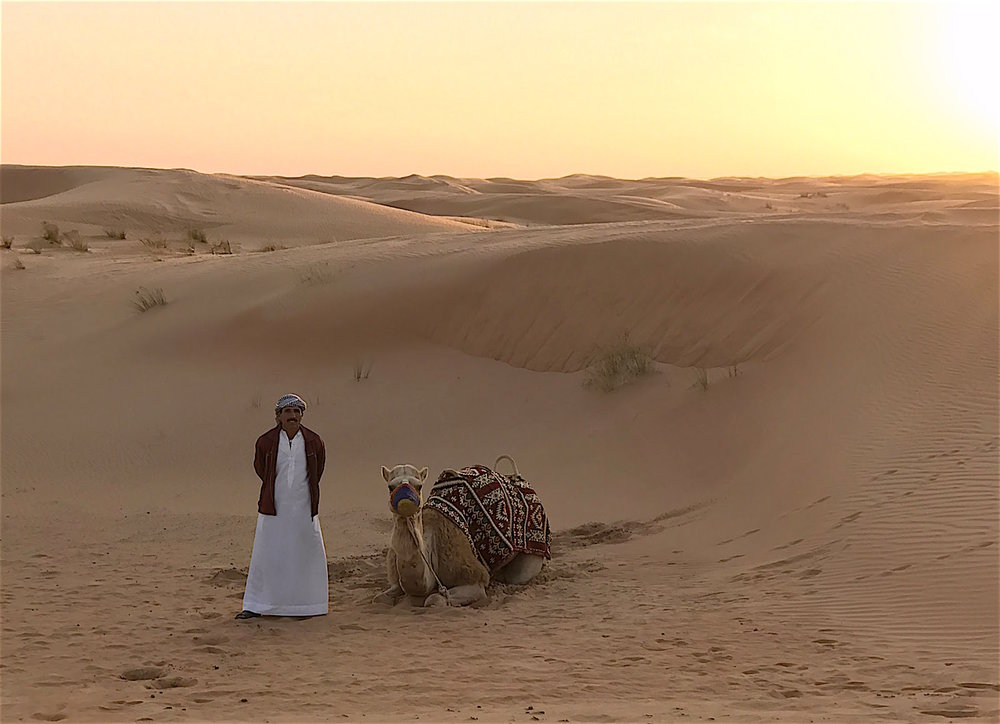 Camel and Trainer in the Arabian Desert, Dubai
