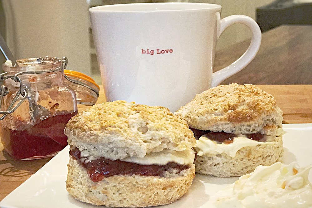 A couple of scones with jam and tea