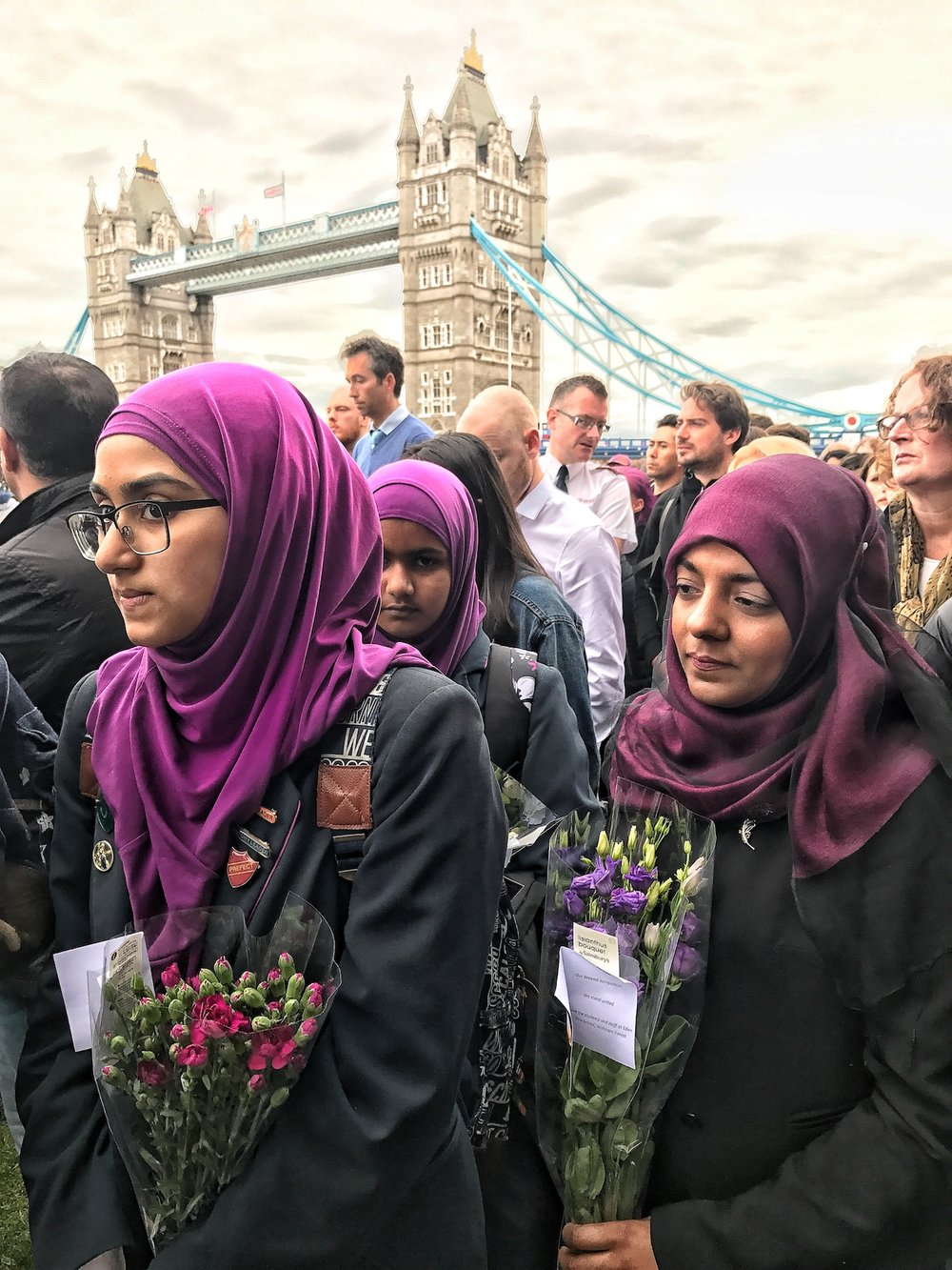 Muslim women carrying flowers to show respect for the victims of the London Bridge and Borough Market terrorist attack.