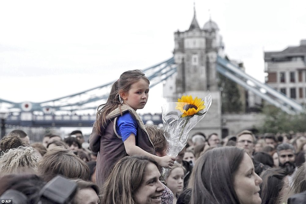 Young Girl Holding a Sunflower during Vigil for victims of The London Bridge Attack