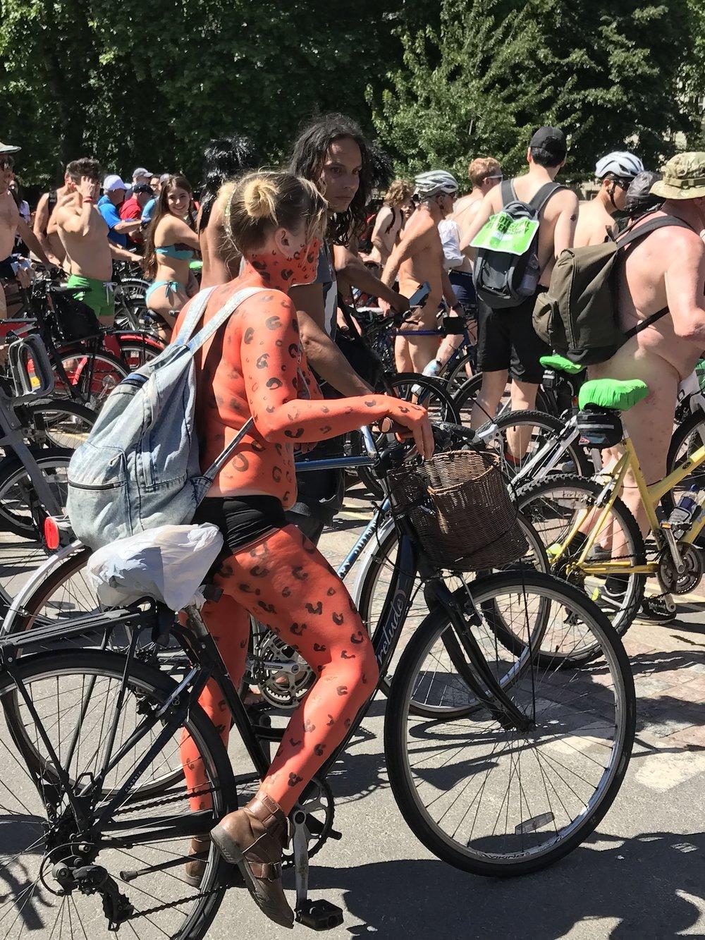 Girl Painted Orange. World Naked Bike Ride 2017. Start Hyde Park London
