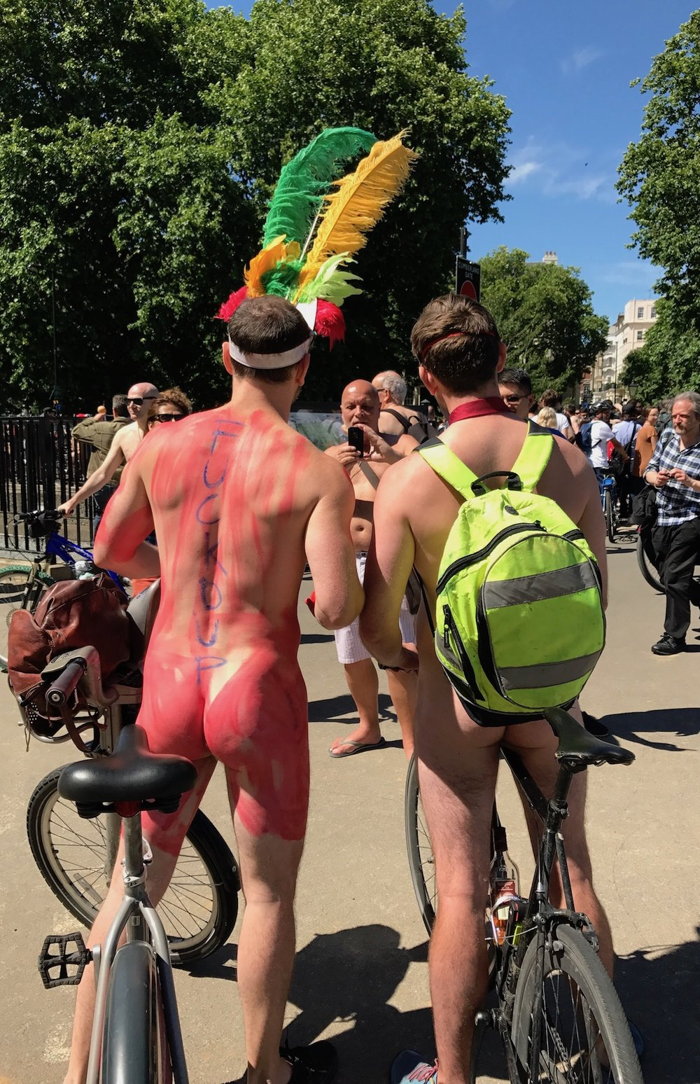 Guy with body paint and feathers. World's Naked Bike Ride London 2017