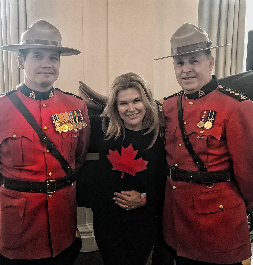 A Broad In London sandwiched between two mounties at Canada House. Canada's 150th