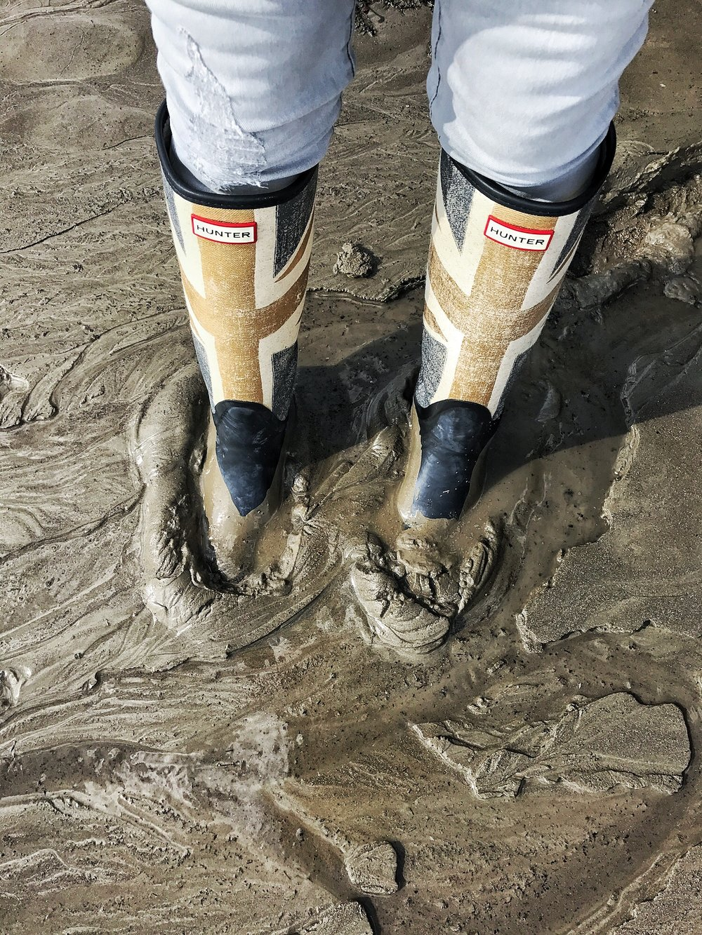 Union Jack Boots in The Mud. A Broad In London Mudlarking On The Thames