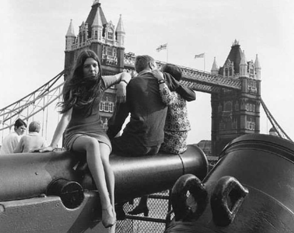 Girl sitting in a mini-skirt in London