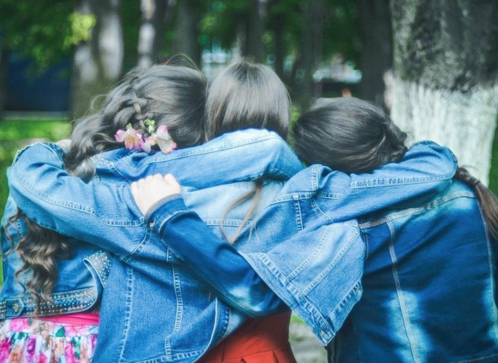 Girlfriends Hugging in Jean Jackets
