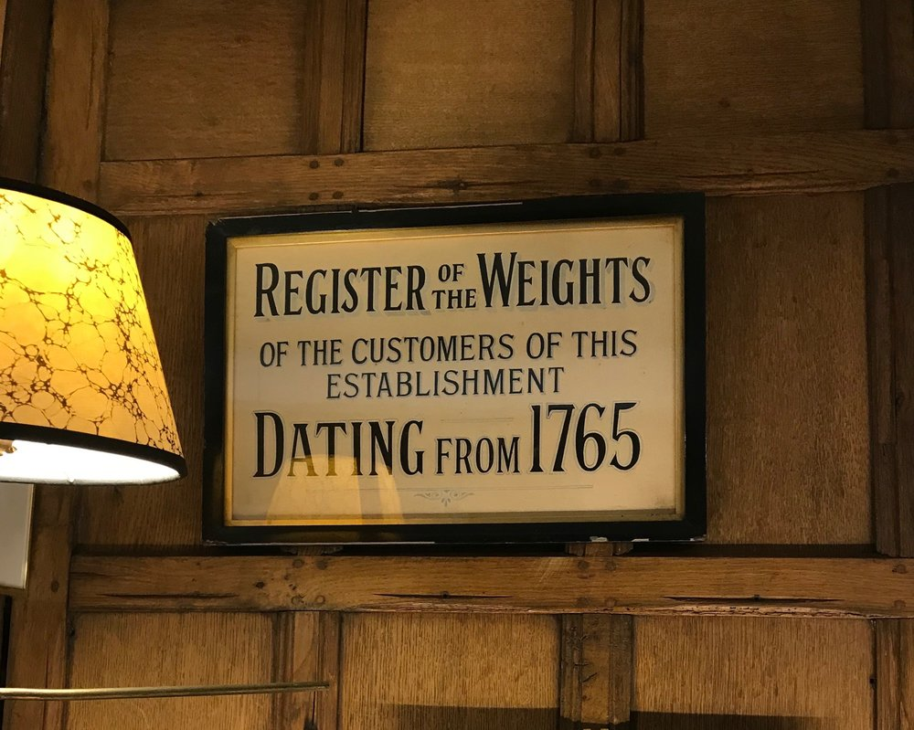 The practice of being weighed was fashionable among the British elite. So not only could you come in and buy wine but you could step on those scales and have your weight recorded.Famous figures in the weighing books included Lord Byron, Beau Brummel and various royals. You can still get weighed at Berry Bros. (nope, not a chance).