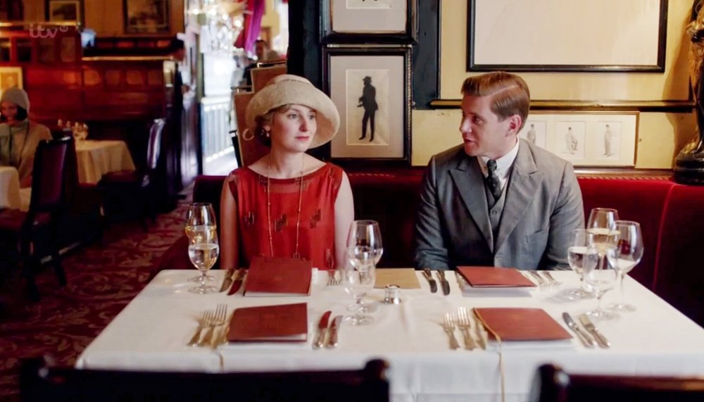 Scene from Downton Abbey with Lady Edith Crawley having lunch at Rules Restaurant. Courtesy of Downton Abbey.