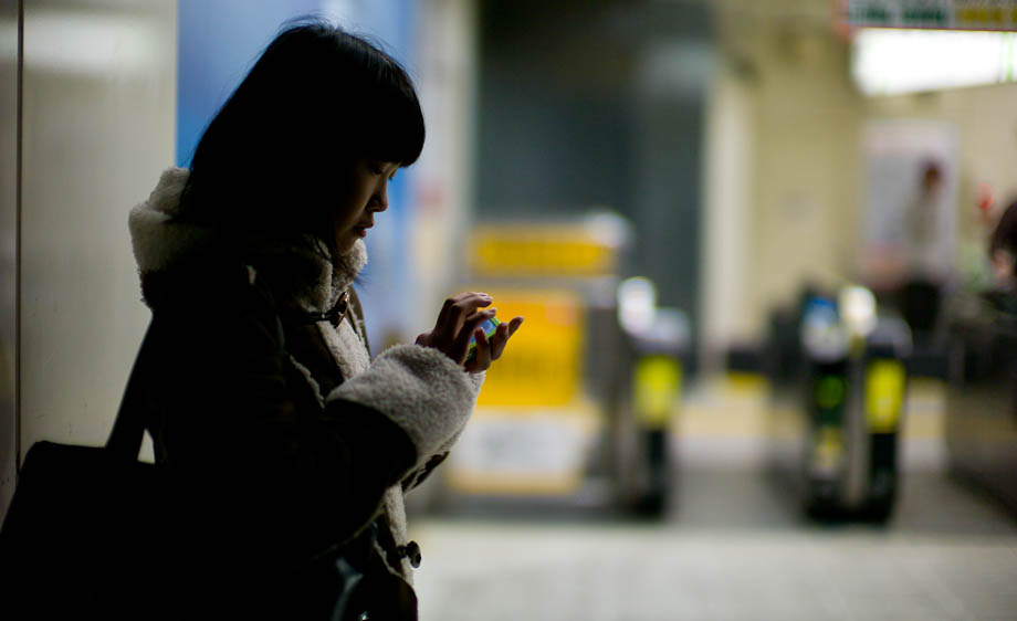 A girl texting at Shibuya Station