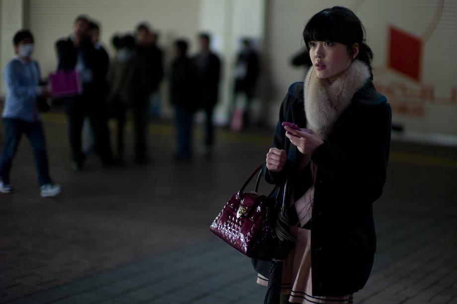 Girl waiting at Hachiko, Shibuya, Tokyo, Japan