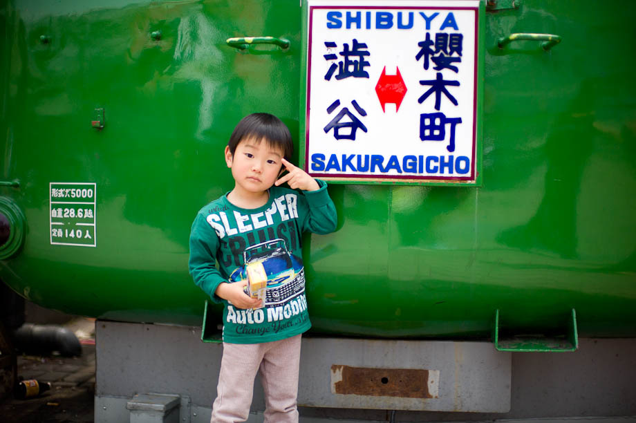 Cute boy in front of Hachiko in front of Shibuya Station