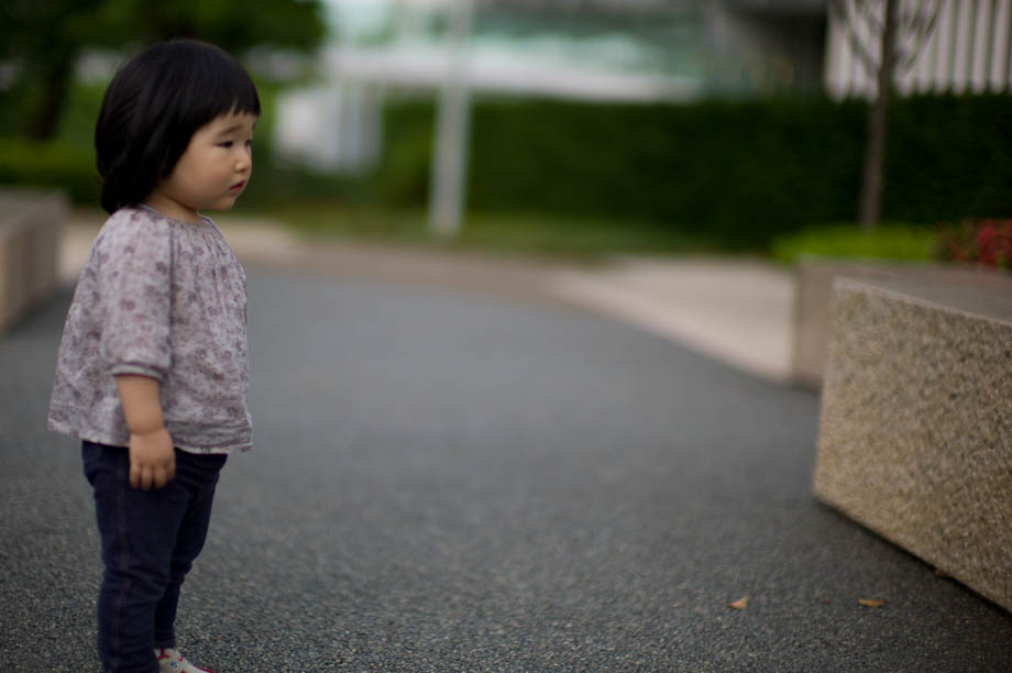 Little girl in park next to Tokyo Midtown