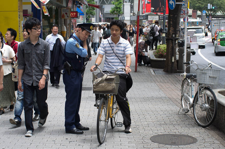 Cops checking bikes in Shibuya