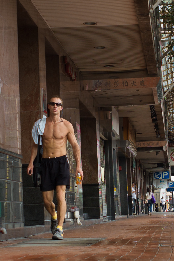 Man running in Causeway Bay in Hong Kong