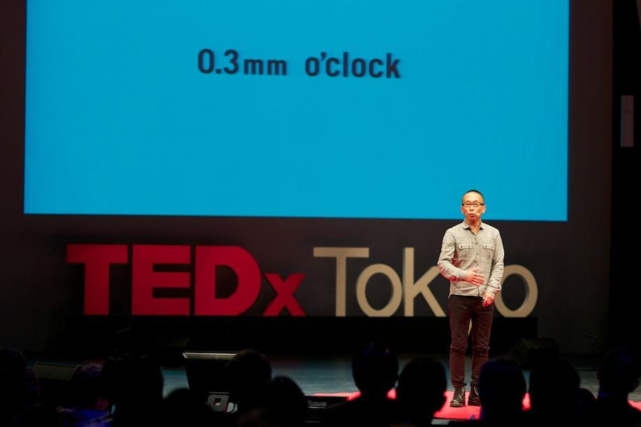 Taku Satoh speaking at TEDxTokyo 2013
