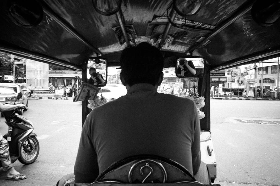 Riding a tuk tuk in Bangkok