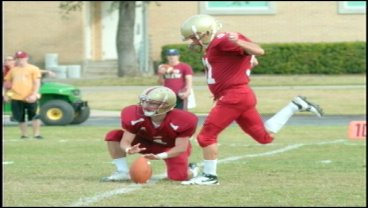 Tom Thompson (R) makes his history-making kick in 2009. (Austin College photo)
