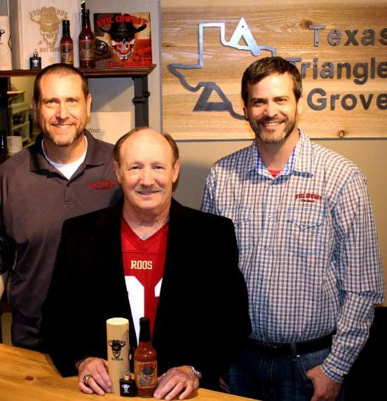 Dr. Emmet C. (Tom) Thompson II has been named Brand Ambassador for Evil Cowboy Hot Sauce. Pictured (L to R): Kyle Riddlesperger, Thompson, Kurt Riddlesperger.         (RDT Photography photo)