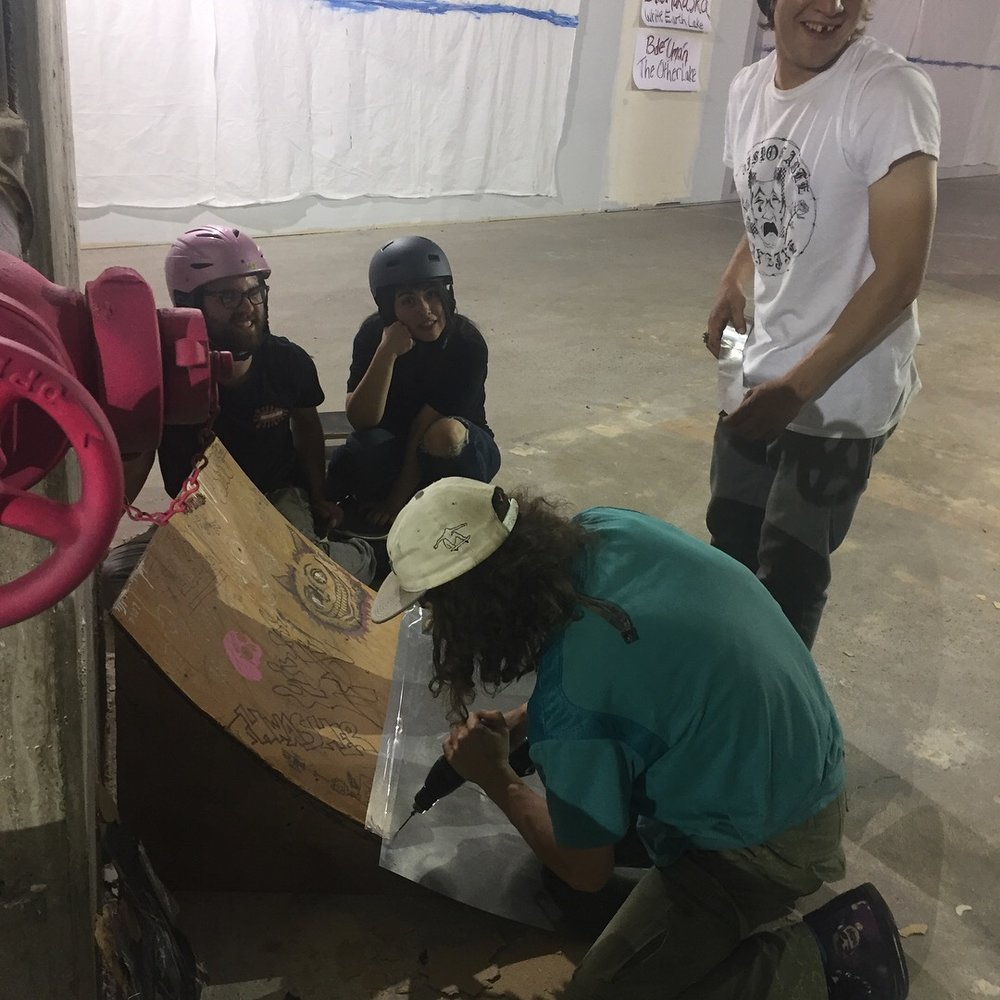 Skateboarder-in-Residence, Max and crew set up a ramp inside the museum