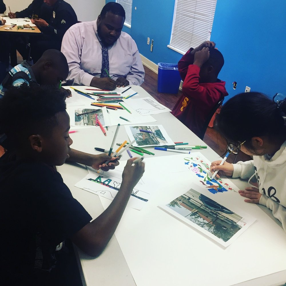 LAPD and children design and paint murals together. Arts Bridging the Gap, 2018