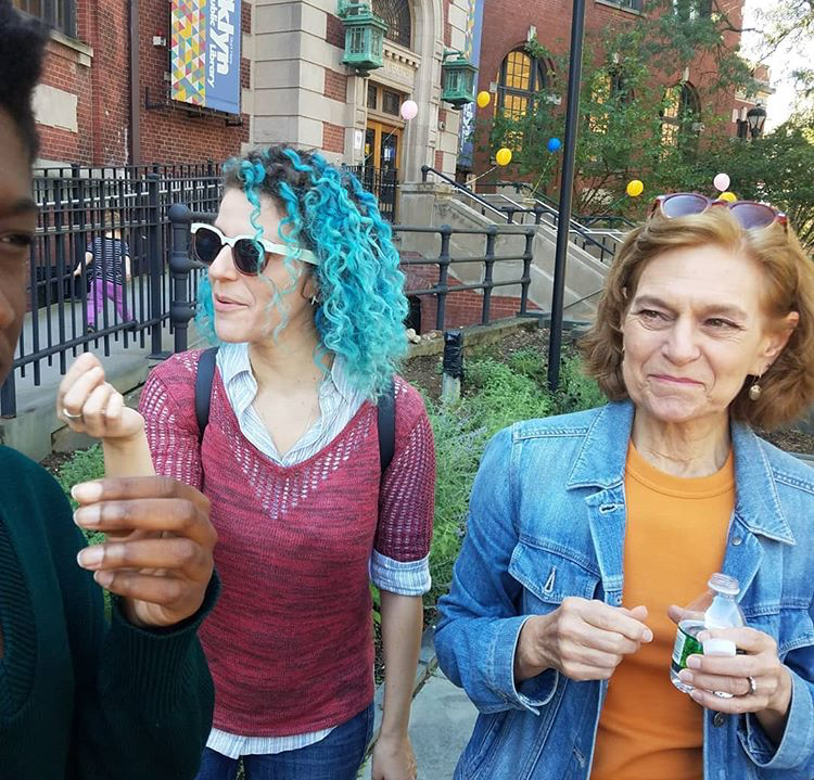 My friends Rachel & Robin try some edible plants from the sidewalk