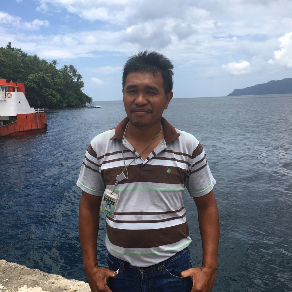 """""""All the trees fell, and, after the big eruption of the Karangetang volcano, it looked like hell was coming out""""   A Siau man shares what it's like to live and raise a family under the world's most active volcano and relays the Indonesian island's mystical beliefs"""