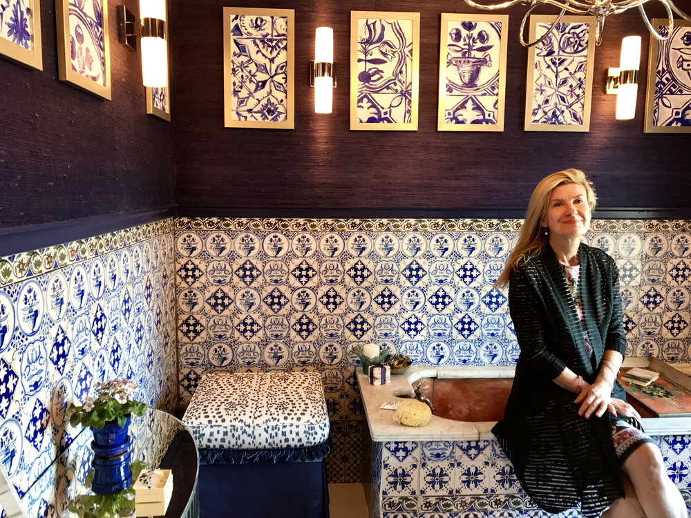 GLEAMING SILVER ACCENTS AND INDIGO BLUE GRASSCLOTH ACCENT THE BEAUTIFUL PAINTED TILES.