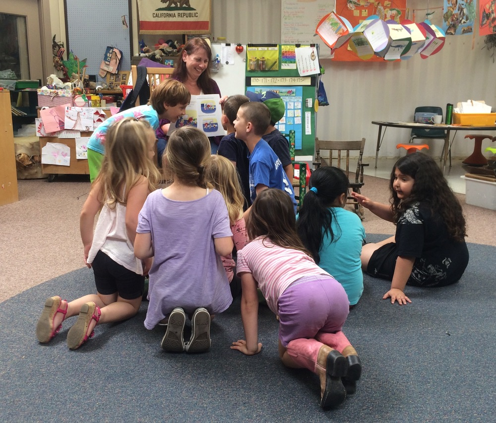 ms. damico's first grade students take a closer look at gymnastics day with silly sammy. i had so much fun reading to these wonderful children! Thank you to all the parents of these beautiful children for allowing me to post this photo on my website. thanks to sarah greenlief for arranging the book reading.