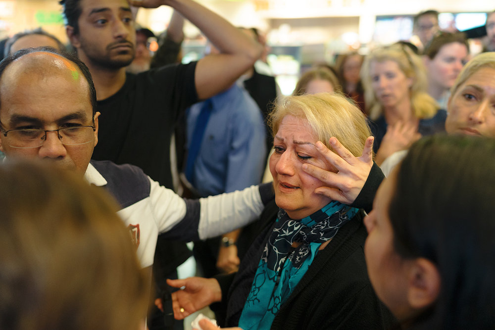 Marjaneh Rezaei tears are wiped away as she's released from TSA detainment at Tom Bradley International Terminal (LAX) on Jan. 29, 2017. Rezaei is an American citizen born in Iraq, one of the countries that was listed on President. Trump's travel ban executive order which targeted countries with a majority Muslim population.