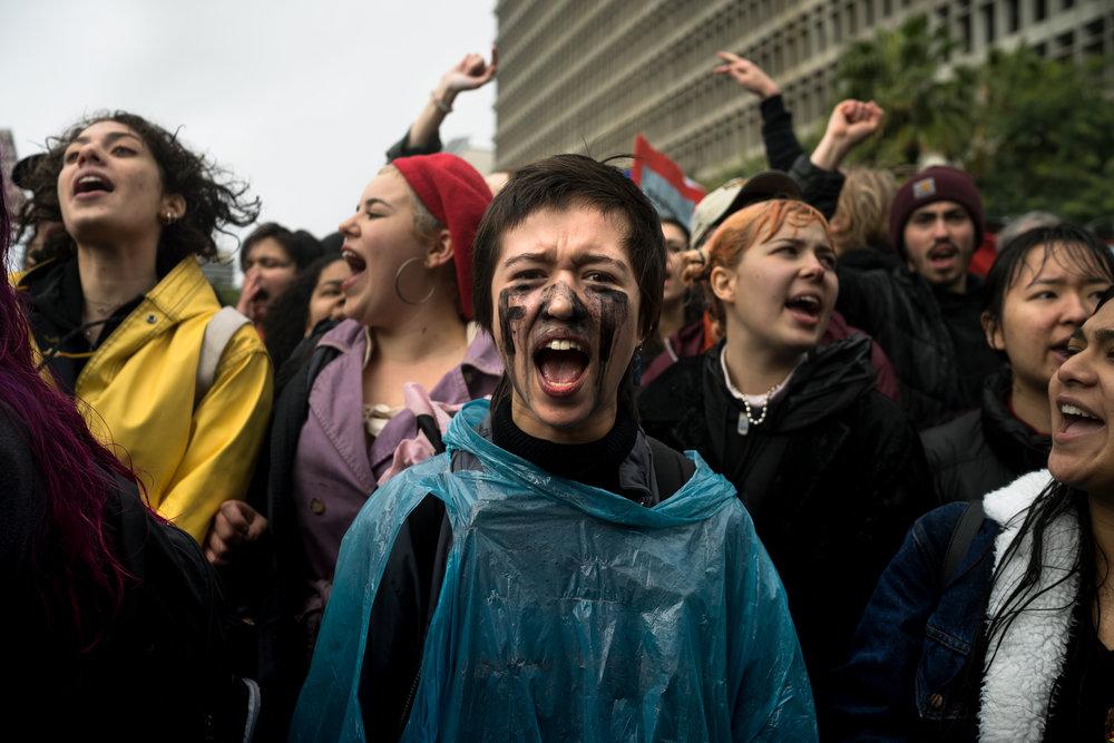 """Ruby Saigon (center) and a group of protesters stand in front of Los Angeles City hall chanting """"Not my President"""" during a protest of the Presidential Inauguration of Donald J. Trump on Jan. 20, 2017."""