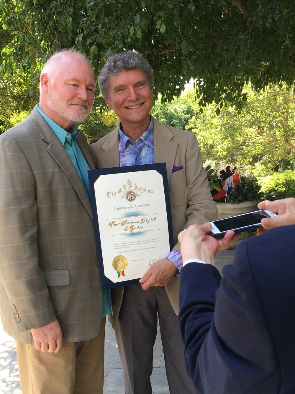 Daniel Tamm, Representative of Mayor Eric Garcetti presents Peace Award to Dr. Paul Kaye, President of PAL&G.
