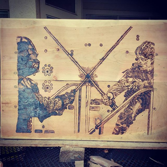 New #vader vs #lukeskywalker end table I finished burning today. Now just some stain and poly and she will be up for sale.  #wood #woodworking #woodburning #starwars #art #lightsaber #theforce #geek