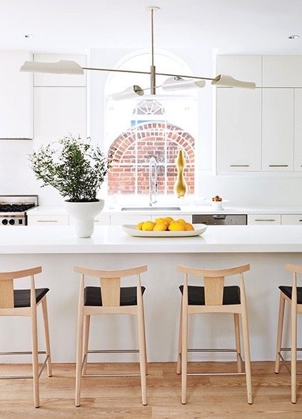 Lloyd Ralphs white kitchen with the Smile stool || via The Design Edit